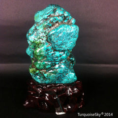 Natural blue turquoise stone with redwood stand 455.0 grams