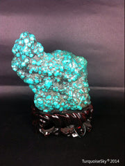 Natural blue turquoise stone with redwood stand 486.4grams