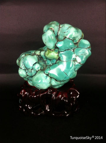 Natural blue turquoise stone with redwood stand 372.2 grams