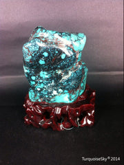 Natural blue turquoise stone with redwood stand 385.2 grams