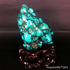 Natural blue turquoise stone with redwood stand 172.2 grams