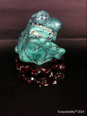 Natural blue turquoise stone with redwood stand 245.4 grams