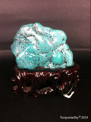 Natural blue turquoise stone with redwood stand 218.2 grams
