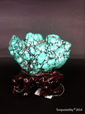 Natural blue turquoise stone with redwood stand 197.4 grams