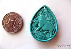 Dual-side hand carved natural turquoise pendant  9.2 grams