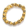 Skull Beads in Hand Carved Cow Bone Stretch Bracelet