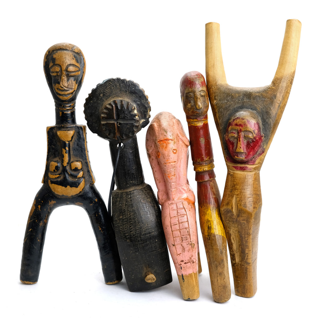 Four Baule Slingshots and One Senufo Heddle Pulley Group from Cote d'Ivoire