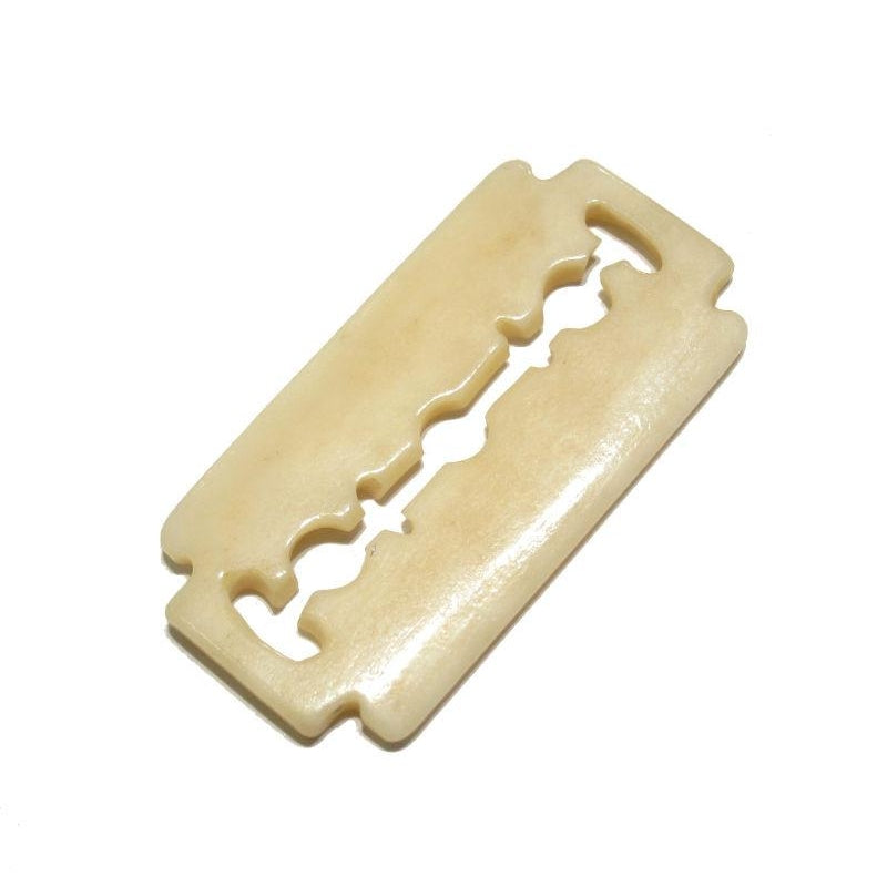 """A Non-Hazardous"" Safety Razor Blade Hand Carved Cow Bone Pendant"