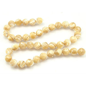 Mother of Pearl Faceted Rounds 10mm Strand