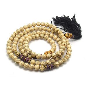 Ruby and Rattan Seed Pod Mala with Brass and Bone Skull Accents