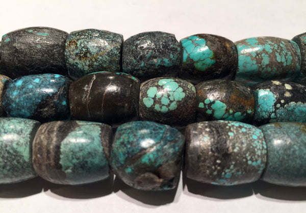 Turquoise Chinese Natural Hand Ground Barrels Sizes range 14-15mm wide x 14-17mm long Bead strand length approx. 16""