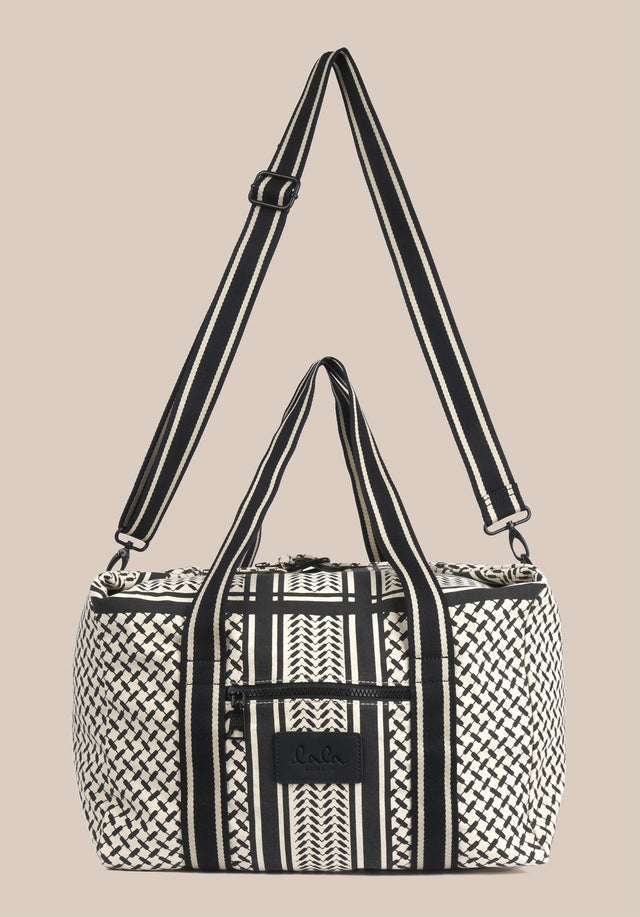 Big Bag Muriel Kufiya Off-White_Black - A spacious weekender made of off-white canvas with a black...