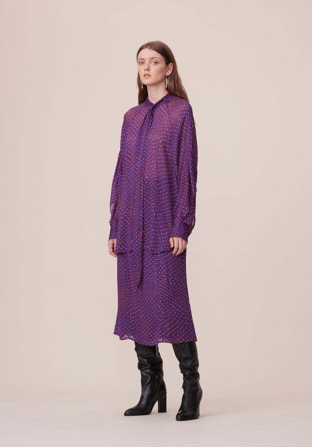 Blouse Bianka Polka Kufiya Purple - An oversized blouse made of flowing viscose with a feminine...