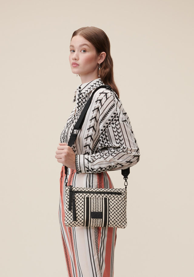 Crossbody Zabiana Kufiya Off-White_Black - A casual shoulder bag made of canvas, featuring a black...