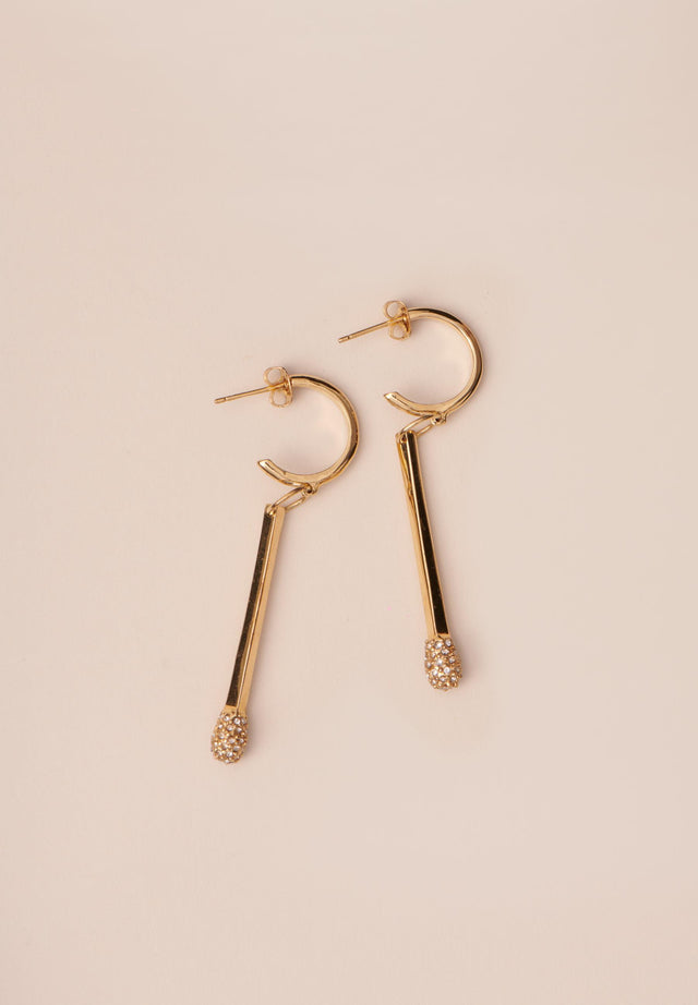 Earring Annik Gold - A delicate earring with an open creole and match shaped...