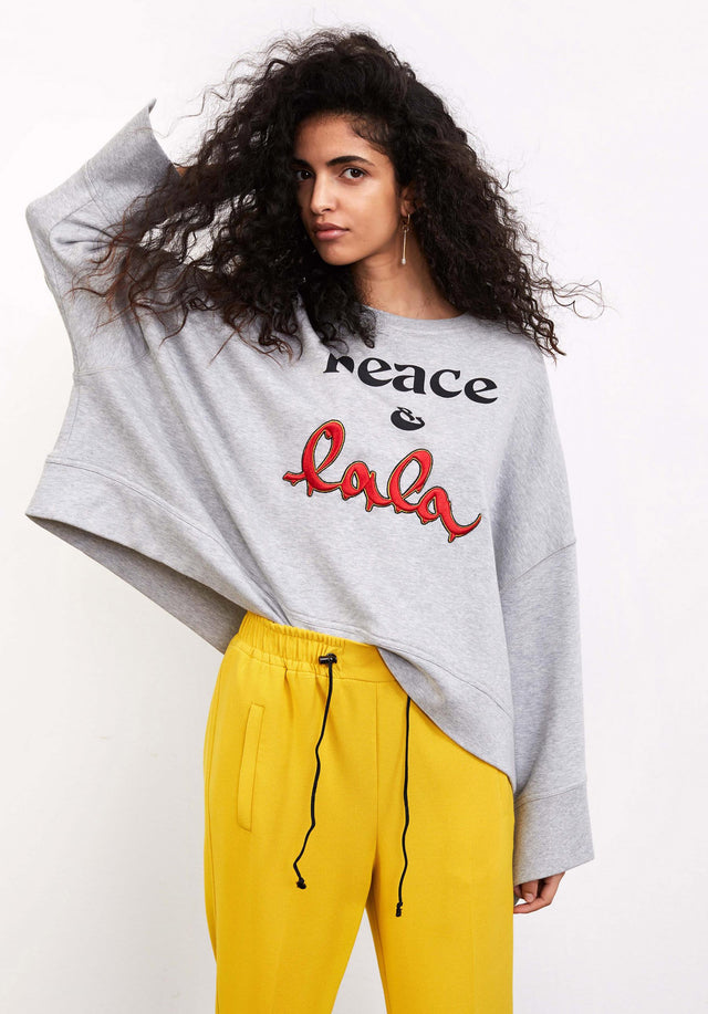 Sweatshirt Insa Grey Melange - An oversized sweatshirt made of jersey with asymmetrical sleeves, a...