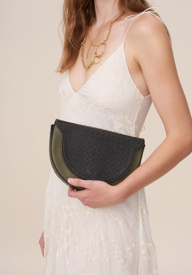 Half Moon Bag Aileen Olive/Classic Kufiya Black - A half moon shaped crossbody bag made of vegan leather,...