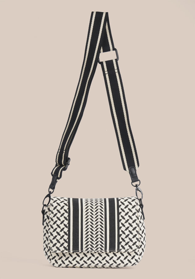 Crossbody Annabella Kufiya Off-White_Black - A handy crossbody bag made of off-white canvas with a...