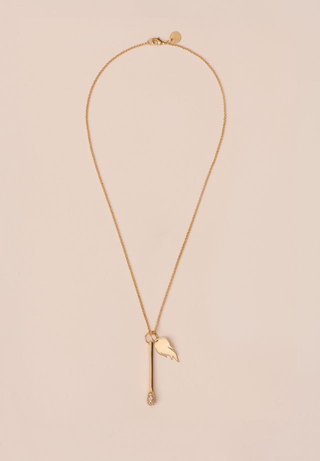 Necklace Attalia Gold - A delicate necklace with a flame and match pendant, topped...