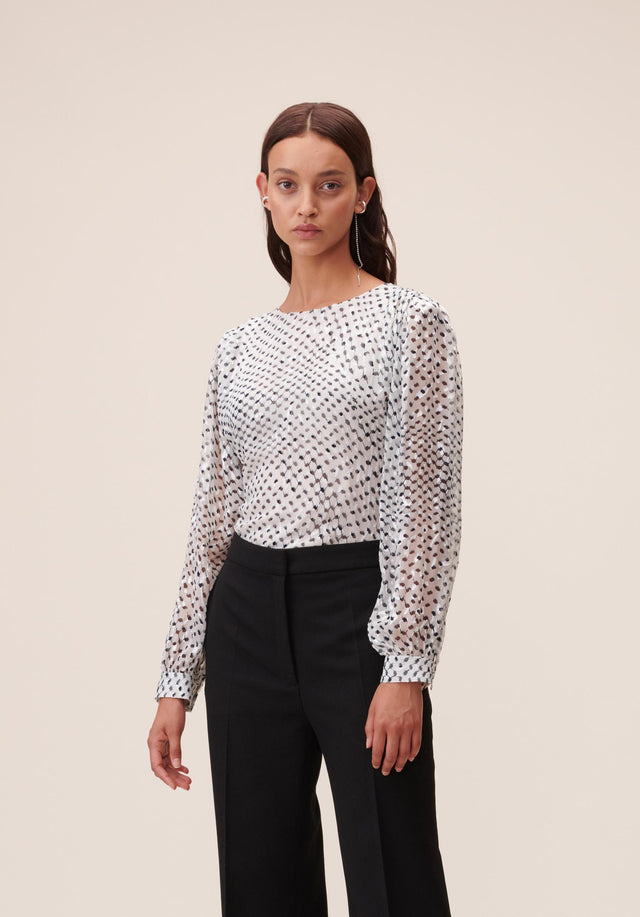 Top Tamia Polka Kufiya White - A simple, yet elegant top with wide sleeves, accentuated shoulders...