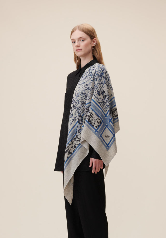 Triangle Butterfly M Butterfly Flanella and Blue - A luxurious triangle made of soft cashmere, showing an abstract...