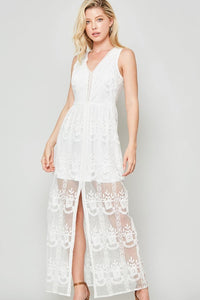 An embroidered floral lace maxi dress that features a high-waist dress