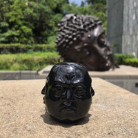Four Faces Buddha