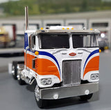 SALE ITEM 1/64 DCP/FIRST GEAR PETERBILT 352 BLUE/ORANGE WITH FLAT TOP TRAILER