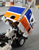 1/64 DCP/FIRST GEAR PETERBILT 352 BLUE/ORANGE WITH FLAT TOP TRAILER