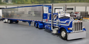 1/64 DCP PETERBILT 379 BLUE WITH SILVER STRIPES AND CHROME SIDED TRAILER NEW IN BOX