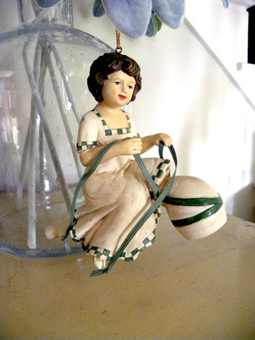 St Patrick's Girl sitting on a Pipe