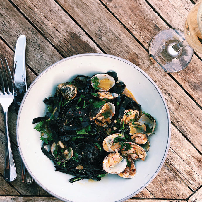Squid ink fettuccine vongole with nduja