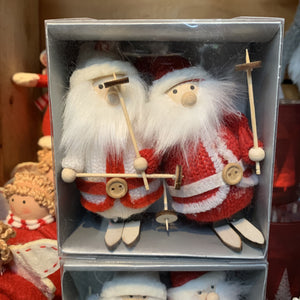 SET OF TWO FABRIC SANTAS ON SKIS