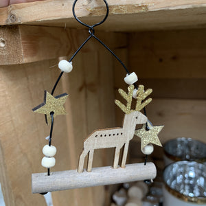 HANGING WOODEN DEER WITH GOLD STARS