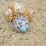 [KPG10-LAR] Pear shape larimar with sea tutle , round Mother of pearl pendant with Blue Topaz stones .
