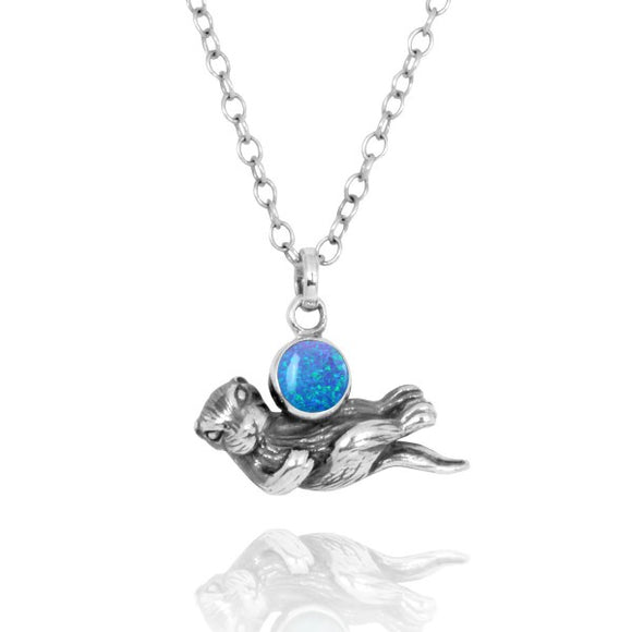 [NP12863-BLOP] Floating Sea Otter Holding Round Simulated Blue Opal Oxidized Silver Pendant