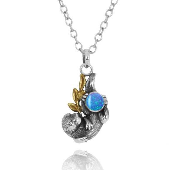 [NP12864-BLOP] Oxidized Silver Otter With Gold Holding Round Simulated Blue Opal Pendants