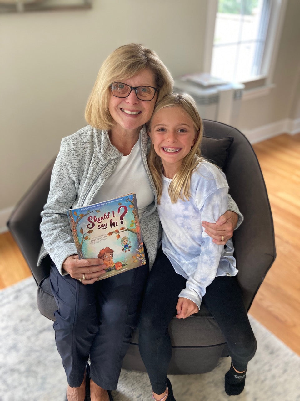 Grandmother and teacher reading Should I Say Hi? to granddaughters class.