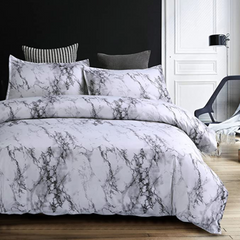 Bed made with marble bedding