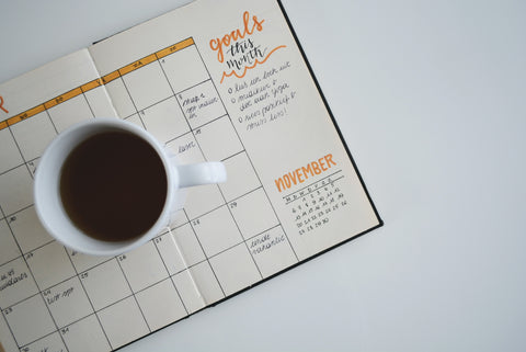 Coffee and planner in dorm