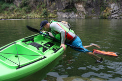 Using a stirrup to get back onto a sit on top kayak