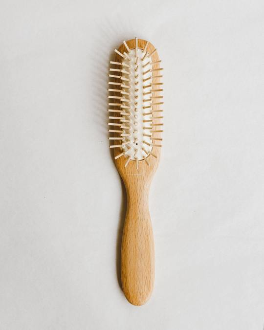 Natural plastic free wooden hair brush
