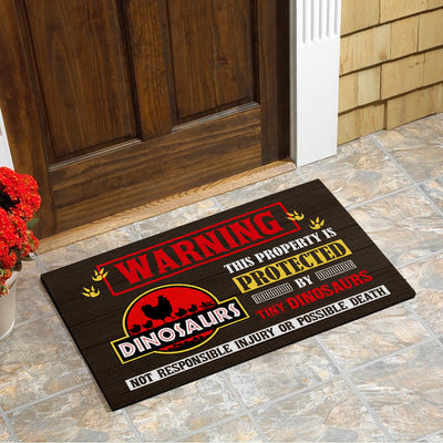 This Property Is Protected By Highly Trained Dinosaurs - Diosaurs Doormat