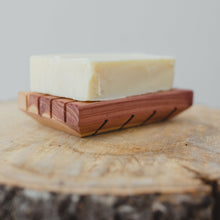 Load image into Gallery viewer, All-natural shampoo bar on natural Cedar soap saver.