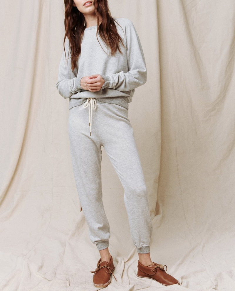 The Cropped Sweatpant in light heather grey