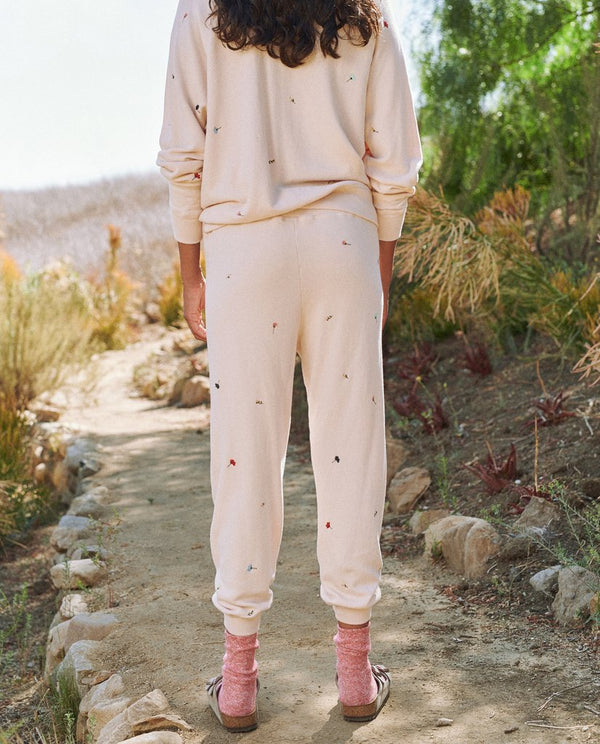 The cropped sweatpant with tossed floral in whisper pink