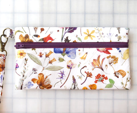 Wristlet Zipper Pouch: Floral Eve with Plum Zip