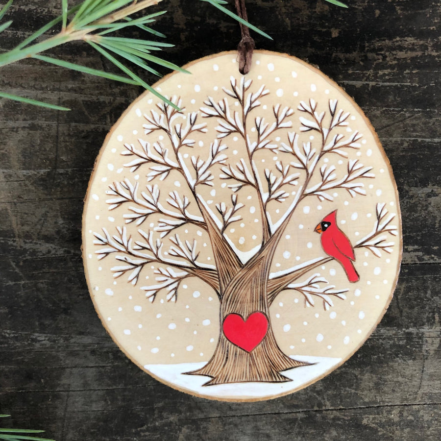 Snowy winter tree with red cardinal wood slice ornament