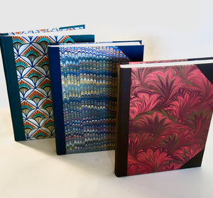 Sketchbooks bound in marbled / decorated paper