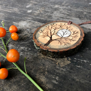 Winter tree silhouette and full moon wood slice ornament
